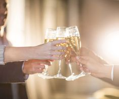 Close-up of group of businesspeople toasting glasses of champagne in t